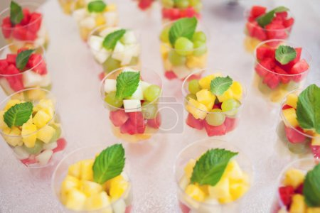 Photo for Desserts with mix of fruits in glasses on the table - Royalty Free Image