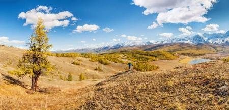 Man in Mountains looking at Lake in Altai, Siberia