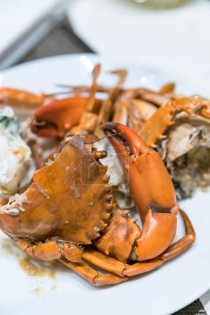 Steam crab in white dish