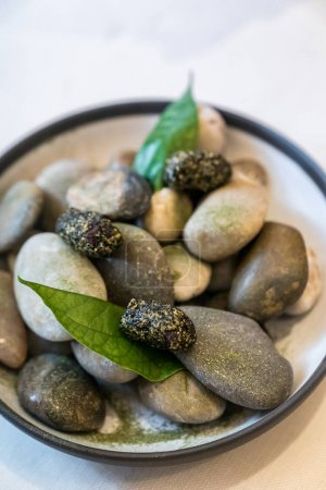 Japanese stones with green leaves