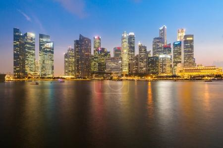 Photo for Singapore downtown cityscape with modern skyline and  city skyscraper sunset at Marina Bay - Royalty Free Image