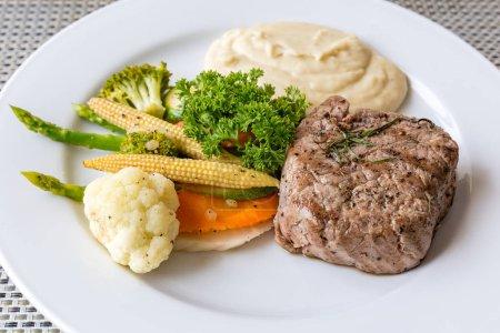 grilled fillet steak served with vegetable and mash potato