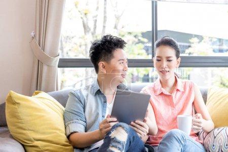 Asian Couple using digital tablet