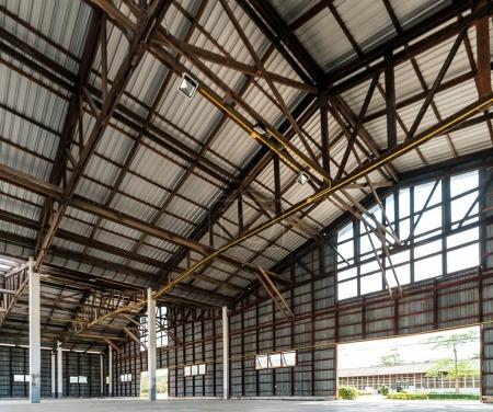 Empty old and rustic hangar building...