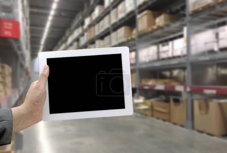 Abstract Blurred background of Warehouse cargo with digital monitor