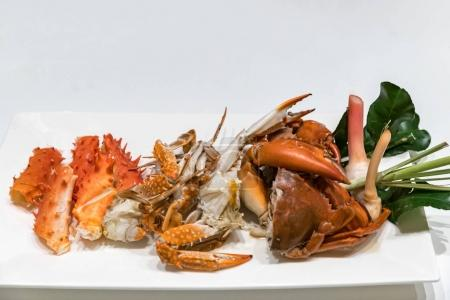 variety of Steam crab in white dish
