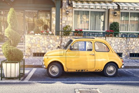 Italian yellow car parked in