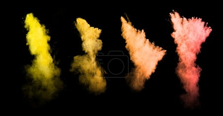 Explosion of colored powders on black background