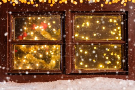Atmospheric Christmas window with falling snow
