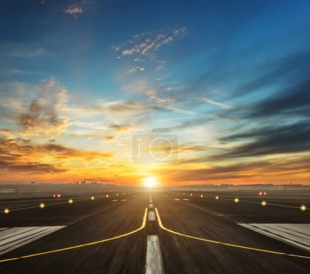 Photo for Airport runway in the evening sunset light, ready for airplane landing or taking off - Royalty Free Image