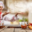 Young chef woman cooker gesturing on copyspace. Ra...