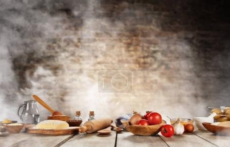 Baking ingredients placed on wooden table