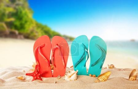 Photo for Tropical beach with colored flip flops, summer holiday background. Travel and beach vacation, free space for text. - Royalty Free Image