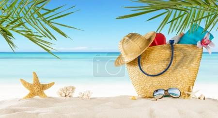 Photo for Tropical beach with sunbathing accessories, summer holiday background. Travel and beach vacation, free space for text. - Royalty Free Image