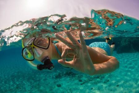 Snorkeling woman exploring beautiful ocean sealife, underwater p