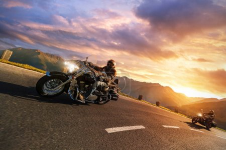 Motorcycle drivers riding in Alpine highway. Outdoor photography