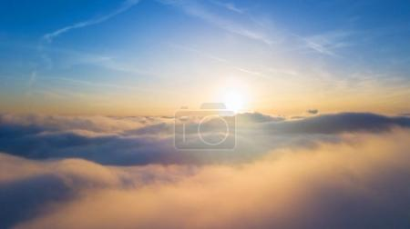 Beautiful sunset above clouds