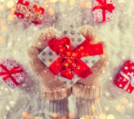 Woman hands holding Christmas gift.