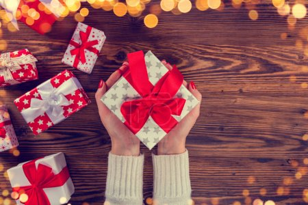 Woman hands holding Christmas gift