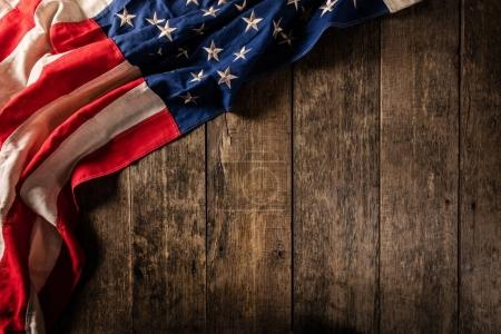Close-up of USA flag in grunge design, placed on old wooden plan
