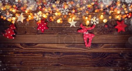 Christmas background with wooden and cloth decorations and spot