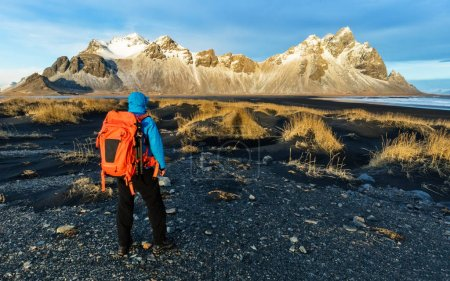 Young man traveler with backpack, Iceland