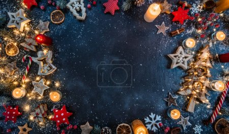 Christmas background with wooden decorations and candles. Free s