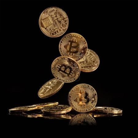 Bitcoins, cryptocurrecny of future. Isolated on black background