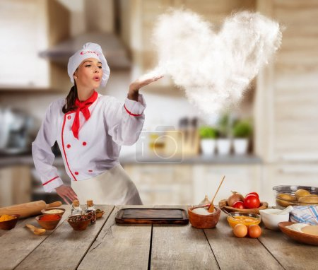 Young woman as chef in kitchen, concept of food preaparation