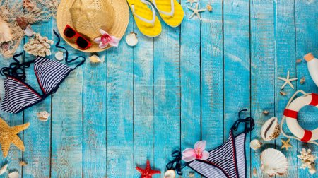 Photo for Beach accessories placed on blue wooden planks, top view. Summer holidays concept, free space for text. Very high resolution image - Royalty Free Image