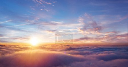 Photo for Beautiful sunset sky above clouds with dramatic light. Cabin view from airplane - Royalty Free Image