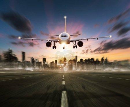 Passengers commercial airplane landing on runway