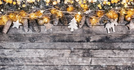 Photo for Decorative wooden traditional Christmas garlands with free space for text. - Royalty Free Image