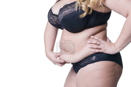 Plus size model in black lingerie, overweight female body, fat woman with flabby stomach isolated on white background