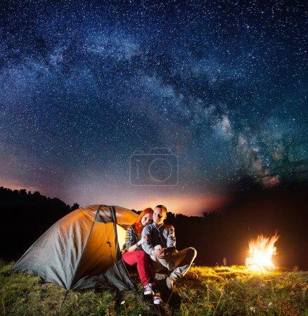 Night camping. Romantic couple