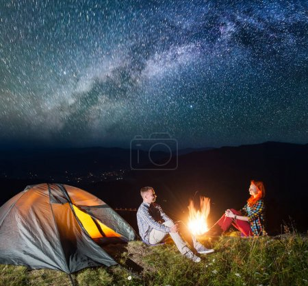 Night tent camping. Happy couple tourists