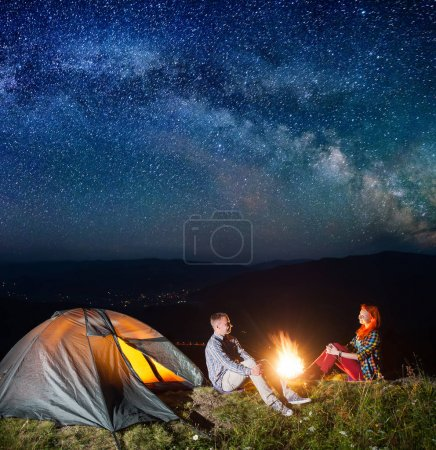 Night camping. Young couple tourists