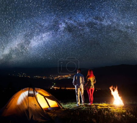 Night camping. Young pair hikers