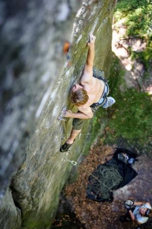 Muscular rock climber