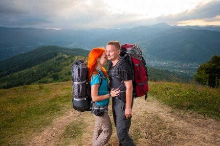 couple hikers in mountains