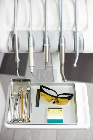 Modern dental instruments in white and grey colors used by dentists