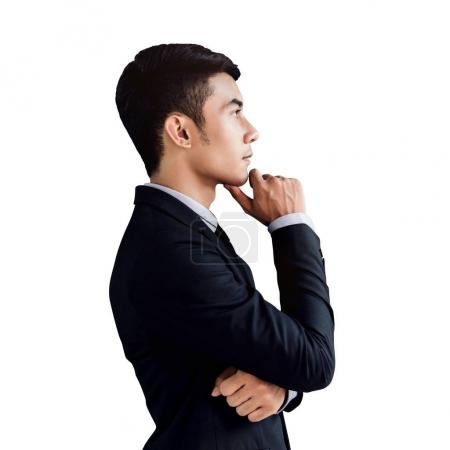 Photo for Side view Portrait of a confident handsome asian businessman, hand on chin and thinking or looking for success in life and work, Isolated on white background - Royalty Free Image