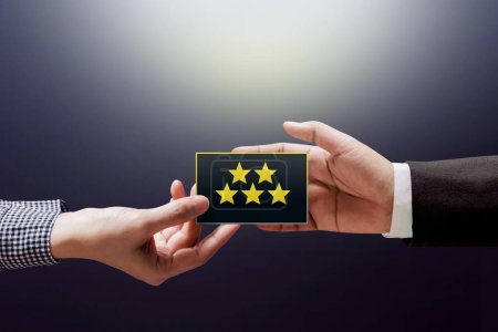 Customer Experience Concept, Happy Client Woman giving a Feedback with Five Star Rating on Card into a Hand of Businessman