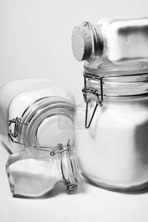 Jars with various food items in a home kitchen