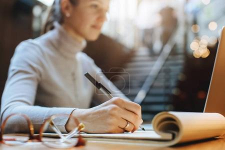 Close-up image of professional businesswoman working at her office via laptop