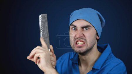 Angry crazy bearded doctor with a butcher knife