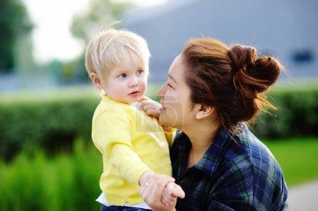 Young asian women with cute caucasian toddler boy