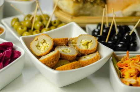 Photo for Savory mini scotch eggs in white ceramic bowl, traditional English snack, appetizer - Royalty Free Image