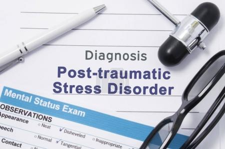 Photo for Diagnosis Posttraumatic Stress Disorder. Medical note surrounded by neurologic hammer, mental status exam with an inscription in large letters psychiatric diagnosis of Posttraumatic Stress Disorder - Royalty Free Image