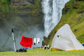 Camping tents near the famous Skogafoss waterfall on Skoga river. Iceland